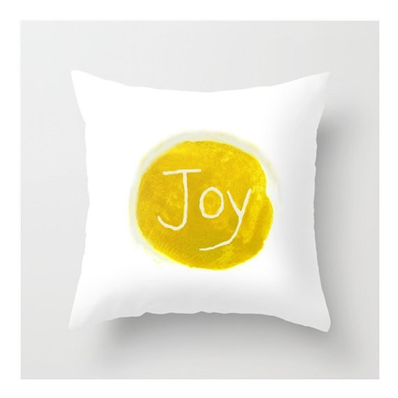 {Joy pillow cover by LovesParisStudio}